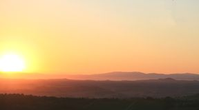 Sunrise in Tuscany. Summer sunrise over the farms and Royalty Free Stock Images