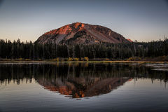 Sunrise at Twin Lakes. Mammoth, CA Perfect October morning with clear skies, fall colors and the sun rising over the mountain. The reflection of the mountain Stock Photography