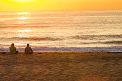 Sunrise Beach Men Sitting Royalty Free Stock Image