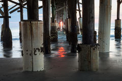 Sunrise under Cocoa Beach Pier Royalty Free Stock Photo