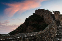Sunrise under the majesty of the Great Wall. Sunset under the towering majesty of the Great Wall, has a historical charm stock photos