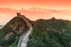 Sunrise under the majesty of the Great Wall. Sunset under the towering majesty of the Great Wall, has a historical charm stock photography