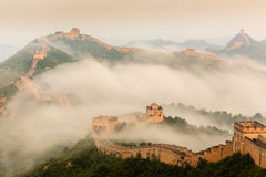 Sunrise under the majesty of the Great Wall. Sunrise under the towering majesty of the Great Wall, has a historical charm stock photo