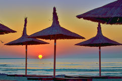 Sunrise under parasol on the beach. Sunrise under parasol on the Black Sea  beach Royalty Free Stock Photos