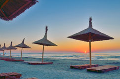 Sunrise under parasol on the beach Royalty Free Stock Images