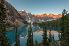 Moraine lake at sunrise in Canadian Rockies. Sunrise under turquoise waters of the Moraine lake in Rocky Mountains, Banff National Park, Canada royalty free stock image