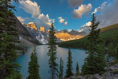 Moraine lake at sunrise in Banff National Park, Canadian Rockies. Sunrise under turquoise waters of the Moraine lake in Rocky Mountains, Banff National Park royalty free stock images