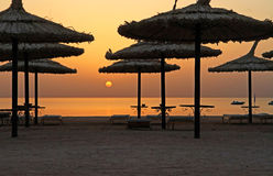 Sunrise under umbrella. Sunrise over Red Sea in Sharm el Sheikh - Egypt Stock Photos