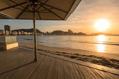 Sunrise Under Umbrella. Sunrise in Copacabana Beach in Rio de Janeiro, Brazil Royalty Free Stock Photography