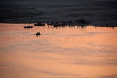 Sunrise at Varanasi. MP094: Sunrise on the Ganges river at Varanasi, Uttar Pradesh, India Stock Photo