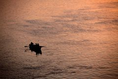 Sunrise at Varanasi. MP097: Tourists take a boat ride on the Ganges river during sunrise at Varanasi, Uttar Pradesh, India Royalty Free Stock Photography