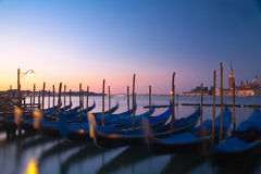 Sunrise in venice and gondolas Stock Images