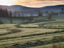 Sunrise on a Vermont Field. Sun just rising over the mountains on a grassy field near Irasburg, Vermont Royalty Free Stock Photo
