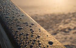 Sunrise in Vero Beach. With water drops on boardwalk railing Royalty Free Stock Images