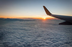 Sunrise view from the airplane window. Beautiful sunrise view from the airplane window Royalty Free Stock Image