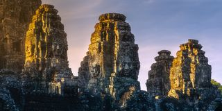 Sunrise view of ancient temple Bayon Angkor with stone faces Siem Reap, Cambodia royalty free stock image