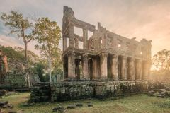 Sunrise view of ancient temple complex Angkor Wat Siem Reap, Cambodia. Sunrise view of popular tourist attraction ancient temple complex Angkor Wat with royalty free stock photo