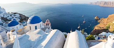 Sunrise view of the blue dome churches of Santorini, Greece. Stock Images