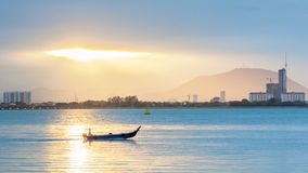 Sunrise view with boat and high rise building. Beautiful landscape series of sunrise and sunset collection from George Town, Penang, Malaysia Royalty Free Stock Photos