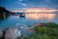 Sunrise view of boats and rocks in George Town. Beautiful landscape series of sunrise and sunset collection from George Town, Penang, Malaysia Royalty Free Stock Photos