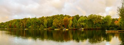 Sunrise view of the Lac Rond. Panoramic view at sunrise of the Lac Rond lake, in Sainte-Adele, Laurentian Mountains, Quebec, Canada royalty free stock image