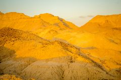 Marlstone rock formation, in Neot HaKikar. Sunrise view of Marlstone rock formation, in Neot HaKikar, northern Arava valley, south of the Dead Sea, Southern Royalty Free Stock Photos