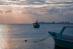 Sunrise View of Mexican Fishing Boat and ponga / skiff in Puerto Juarez Harbor of Cancun Bay Stock Image