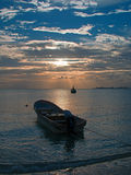 Sunrise View of Mexican Fishing Boat and ponga / skiff in Puerto Juarez Harbor of Cancun Bay Royalty Free Stock Photo