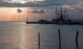 Sunrise View of Mexican Fishing Boats at Puerto Juarez dock / harbor Royalty Free Stock Images