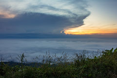 The sunrise view on morning twilight time at the top of mountain with sea of fog Phu Thap Boek Phetchabun Province Thailand Royalty Free Stock Image