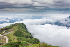 The sunrise view on morning twilight time at the top of mountain with sea of fog Phu Thap Boek Phetchabun Province Thailand Stock Photos