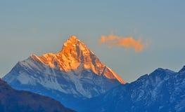 Sunrise view of Nandadevi Peak. Golden sunrise rays on the Nandadevi peak, India Royalty Free Stock Photography