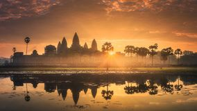 Sunrise view of ancient temple complex Angkor Wat Siem Reap, Cambodia. Sunrise view of popular tourist attraction ancient temple complex Angkor Wat with Stock Photo