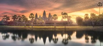 Temple complex Angkor Wat Siem Reap, Cambodia. Sunrise view of popular tourist attraction ancient temple complex Angkor Wat with reflected in lake Siem Reap Royalty Free Stock Image