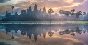 Temple complex Angkor Wat Siem Reap, Cambodia. Sunrise view of popular tourist attraction ancient temple complex Angkor Wat with reflected in lake Siem Reap and royalty free stock image