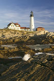 Sunrise view of Portland Head Lighthouse and ocean wave, Cape Elizabeth, Maine Stock Photos