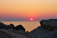 Sunrise view at seaside. Between the rocks on the shore in Costinesti, Romania Royalty Free Stock Images