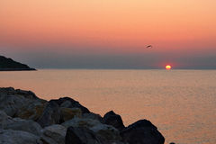 Sunrise view at seaside. Between the rocks on the shore in Costinesti, Romania Stock Photography