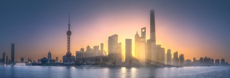 Sunrise view of Shanghai skyline with sunshine. Sunrise scenery view of Shanghai skyline and Huangpu river with reflection of sun on buildings, China Stock Image