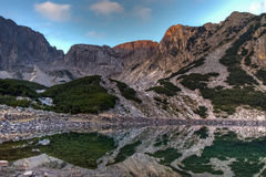 Sunrise view of Sinanitsa peak and lake, Pirin Mountain Stock Photo