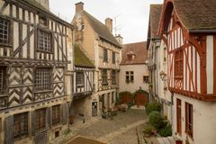 Square with half-timbered houses, in the medieval village Noyers. Sunrise view of a square place de la petite etape aux vins, with half-timbered houses, in the Royalty Free Stock Images