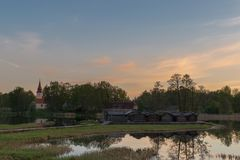 Sunrise view to Araisi church and Araisi lake in Vidzeme, Latvia. Sunrise view to Araisi church and Araisi lake dwelling site - reconstructed wooden village from Royalty Free Stock Photos