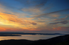 Sunrise view from the top of Cadillac Mountain. Reflecting off of the water Stock Photo