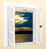 Sunrise view from the window. Beautiful sunrise sunshine view from the window with curtains Stock Photos