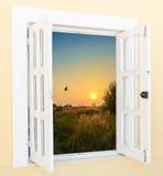 Sunrise view from the window. Beautiful sunrise sunshine view from the window with curtains Royalty Free Stock Photos