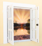 Sunrise view from the window. Beautiful sunrise sunshine view from the window with curtains Royalty Free Stock Images