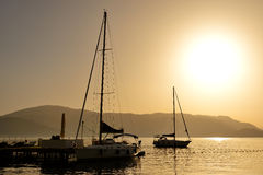 The sunrise and view on yachts harbor Stock Photography