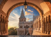 Sunrise viewed through the arches of the Fisherman`s Bastion in Budapest, Hungary stock photos