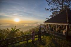 The tourist Sunrise on the PHU RUEA NATIONAL PARK THAILAND Stock Photos
