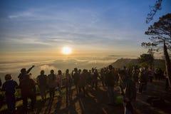 The tourist Sunrise on the PHU RUEA NATIONAL PARK THAILAND Royalty Free Stock Photo